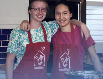 a couple of volunteers working in the kitchen