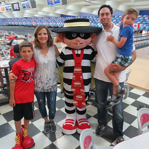 Family attending Bowl-A-Thon and getting photo taken with the Hamburglar