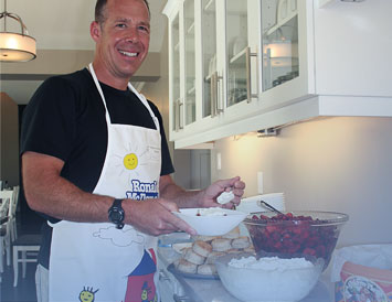 Steve, from Hillman's Kitchen and Bath dinner group,making a strawberry dessert